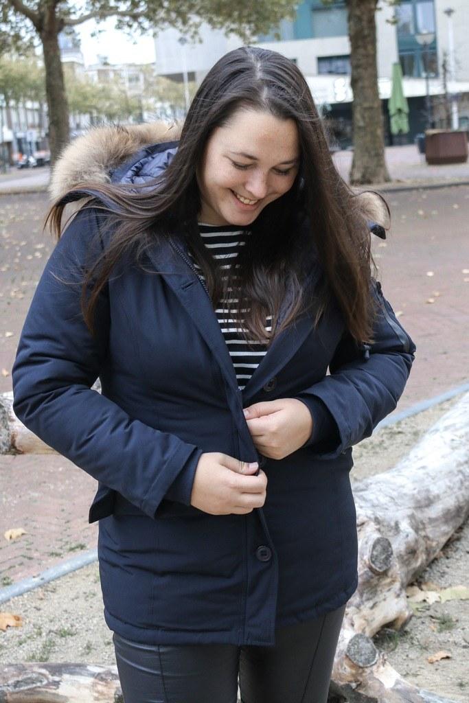 Een winterjas die over mijn mama heupen past!